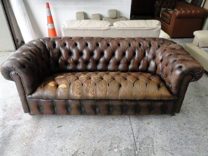 Old Worn Out Deep Buttoned Leather Chesterfield Couch