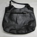 Black leather handbag mildew treated and restored.